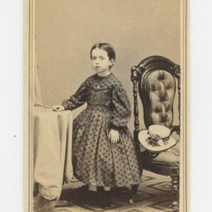 Bogardus CDV – little girl in hooped calico dress, hat, locket